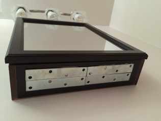 Attach bars to the the cabinet.
