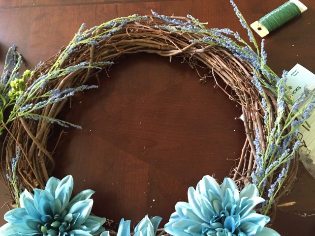 Gather a mix of your flowers and lay them around the wreath.