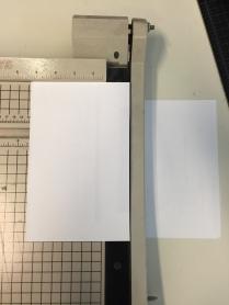 Use a paper cutter or scissors.